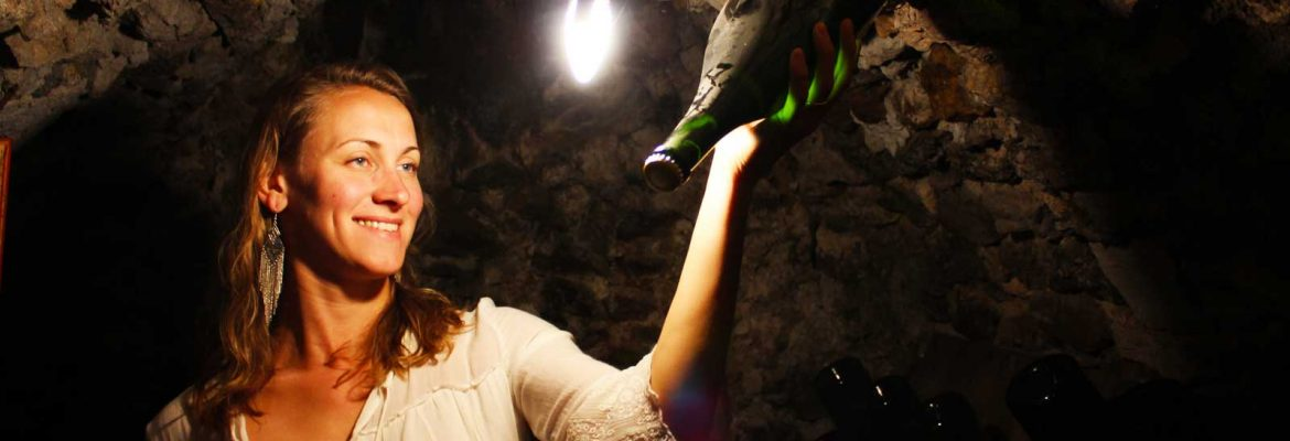 audrey-with-bottle-in-cellar